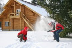 Couple with winter house. Throw snow stock photo