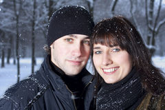 Couple in winter park Stock Images