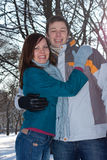 Couple in winter park Royalty Free Stock Image