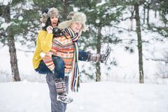 Couple in the winter park Stock Photo