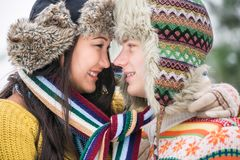 Couple in the winter park Royalty Free Stock Images