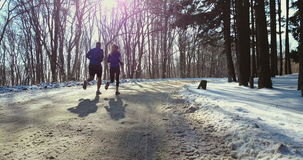 Couple winter running  in snow stock footage