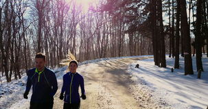 Couple winter running  in snow stock video footage