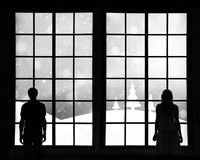 Couple with winter season landscape background Stock Images