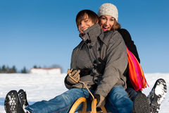 Couple in winter with sled Royalty Free Stock Image