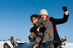 Couple in winter with sled Royalty Free Stock Photo