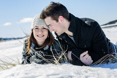 Couple In winter Snow Scene at beautiful sunny day Royalty Free Stock Photo