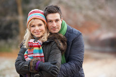 Couple On Winter Walk Through Frosty Land Royalty Free Stock Images