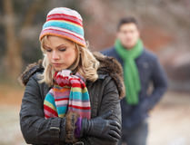 Couple On Winter Walk Through Frosty Landscape royalty free stock images