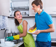 Couple wiping dishes Stock Photography