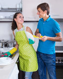Couple wiping dishes Stock Photos