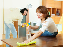 Couple wiping dust at home Royalty Free Stock Photo
