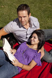 Couple With Dog Reading Royalty Free Stock Photography