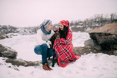 Free Couple With Dog Wrapped In Red Plaid During Winter Walk Stock Image - 112563711