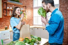 Free Couple With Healthy Food On The Kitchen Stock Photos - 134228663