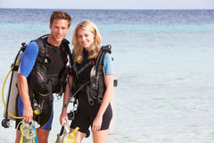 Couple With Scuba Diving Equipment Enjoying Beach Holiday Royalty Free Stock Photos