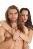Couple woman behind man no shirt close serious Royalty Free Stock Photo