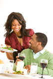 Couple: Woman Brings Food Plate to Dinner Table Stock Photos