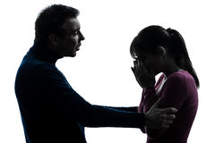 Couple woman crying man consoling   silhouette Stock Images