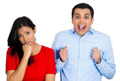 Couple, woman excited, man sad Royalty Free Stock Photography
