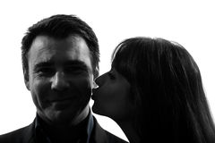 Couple woman kissing man silhouette Stock Photos