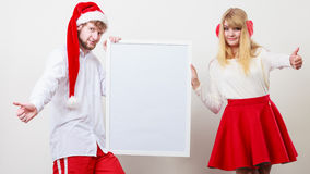Couple woman and man with blank banner. Copy space Stock Photography