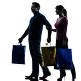 Couple woman man  christmas present shopping silhouette Royalty Free Stock Photo