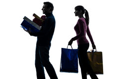 Couple woman man  christmas present shopping silhouette Stock Photo