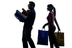 Couple woman man  christmas present shopping silhouette Stock Photography