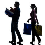 Couple woman man  christmas present shopping silhouette Stock Photos