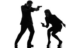 Couple woman man detective secret agent criminal  silhouette Stock Photos