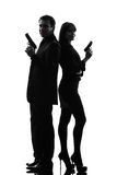 Couple woman man detective secret agent criminal  silhouette Stock Image