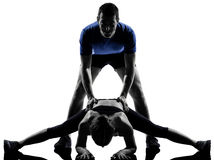 Couple woman man exercising workout Stock Photos