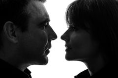 Couple woman man face to face  silhouette. One caucasian couple women men face to face in silhouette studio isolated on white background Stock Photos