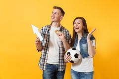 Couple, woman man, football fans holding bitcoin, metal golden coin, up arrow, soccer ball, cheer up support team. Couple, women man, football fans holding royalty free stock photography