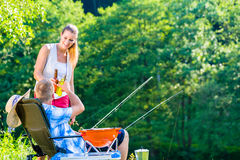 Couple of woman and man having beer while sport fishing royalty free stock image