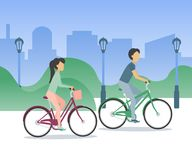 Young couple riding bicycles around the city stock illustration
