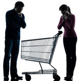 Couple woman man sad with empty shopping cart silhouette Stock Photos