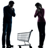Couple woman man sad with empty shopping cart silhouette Stock Photography