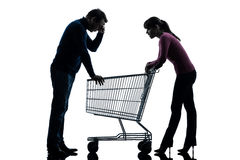 Couple woman man sad with empty shopping cart silhouette Royalty Free Stock Image