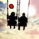 Couple on a seesaw. Inspiration, love and dreams Stock Photography