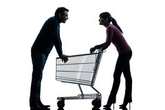 Couple woman man with shopping cart dating flirting silhouette. One caucasian couple women men with shopping cart dating flirting   in silhouette studio  on Royalty Free Stock Photo