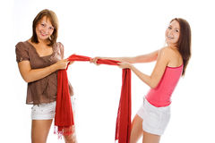 Couple woman pull red scarf Royalty Free Stock Photography