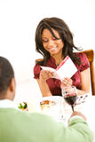 Couple: Woman Reads Romantic Card Royalty Free Stock Photography