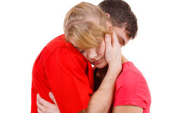 Couple. Woman is sad and being consoled by his partner Royalty Free Stock Photography