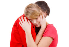 Couple. Woman is sad and being consoled by his partner Royalty Free Stock Images