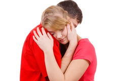 Couple. Woman is sad and being consoled by his partner Stock Photos