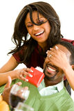 Couple: Woman Surprises Man with Gift Stock Photo