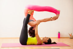 Couple of women doing acroyoga Royalty Free Stock Images