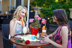 A couple of women drinking cocktail in a restaurant Royalty Free Stock Photography